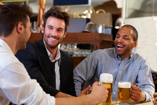 men-drinking-beer-and-smiling